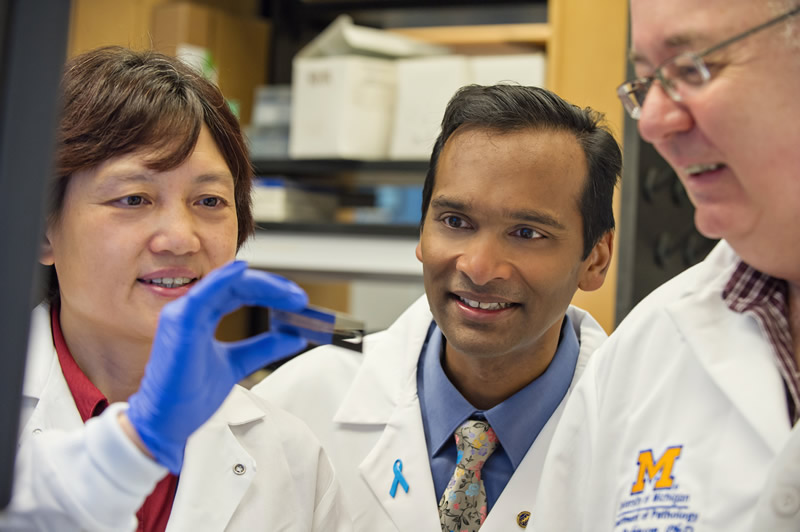 Arul Chinnaiyan, M.D., Ph.D. with members of his lab