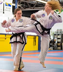 Barbara Hilija Spiessl practicing Taekwon-Do with her sister, Heidi
