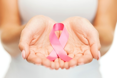 woman holding breast cancer awareness ribbon