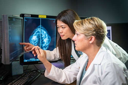 Radiologists look at a mammogram