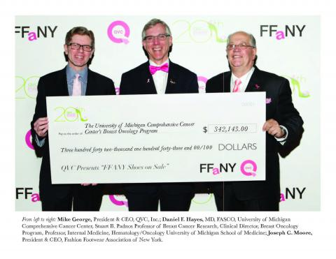 Dr. Daniel Hayes, center, receives a check from FFANY and QVC representatives
