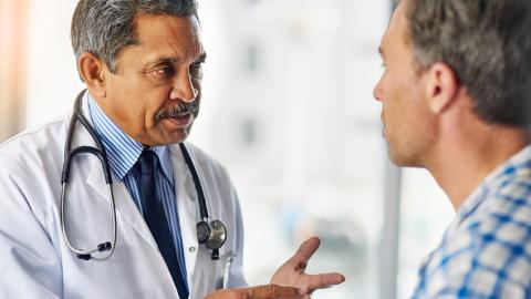 A physician talks to a patient